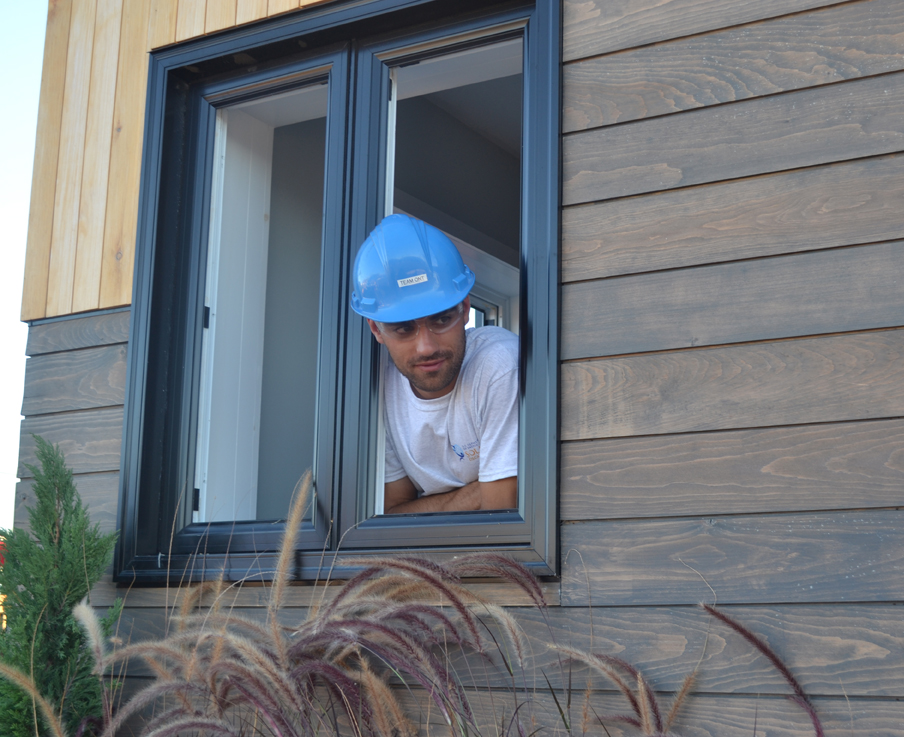 Team Ontario member Karl Kadwell gazes out of an ECHO home window donated by JELD-WEN Canada.