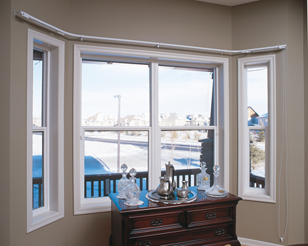 Living room dualpane windows with Low-E glass look out onto a snowy deck