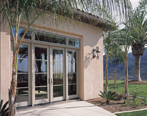 Exterior of a house, showing aluminum-clad wood, swinging patio doors.