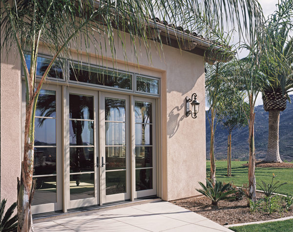 Exterior of a house showing aluminum-clad wood swinging patio doors. & What does a \
