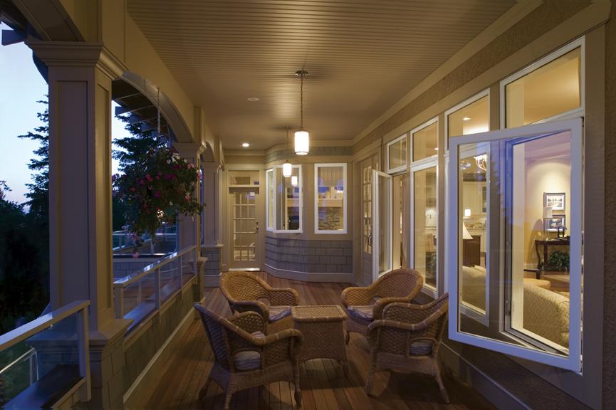 Vinyl windows facing a balcony beneath an overhang.