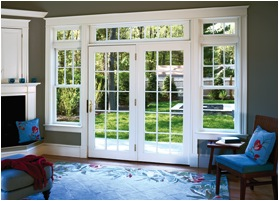 A patio door with Grilles Between Glass overlooking a yard.