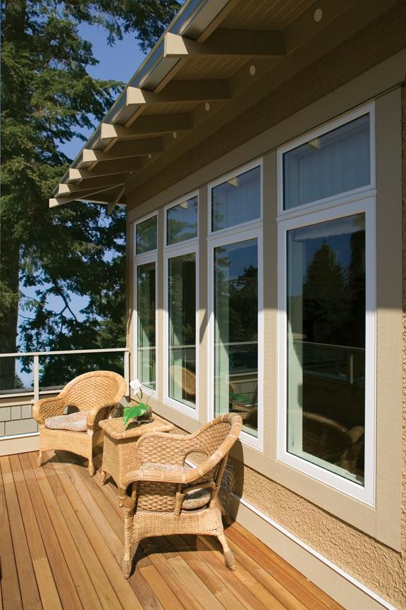 Fixed vinyl windows overlooking a sunny deck.