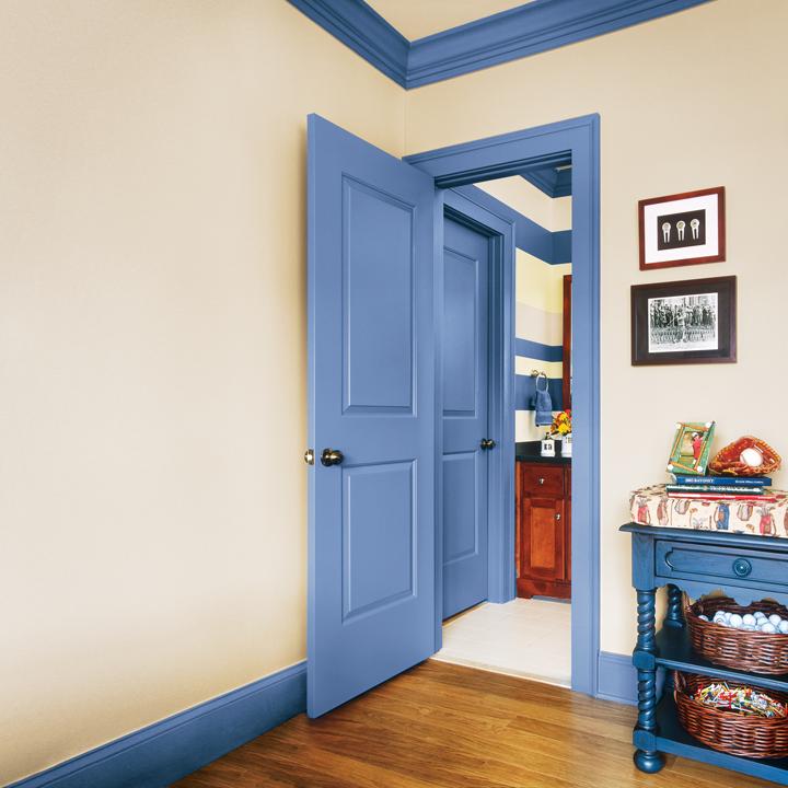 Blue in-swinging door opening into bedroom.