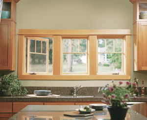 Picture of three windows over a kitchen sink. One of the windows, a casement, is open.