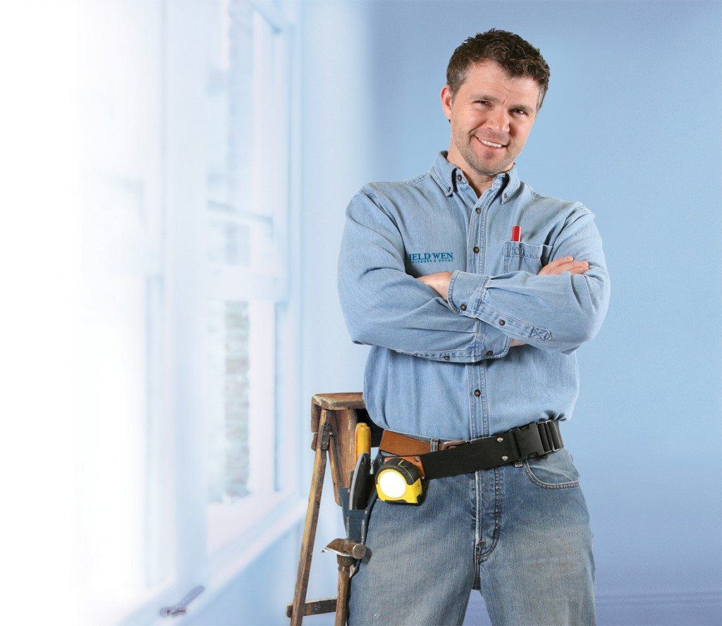 Image of a professional window contractor at an installation site.