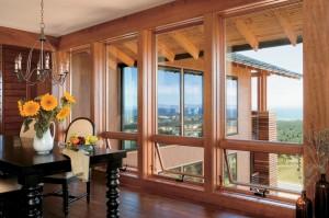 a sprawling mountain view through a wide custom wood window