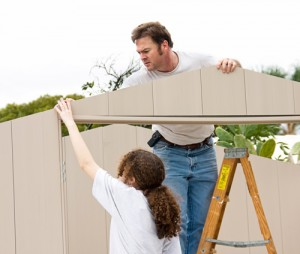 Image of a man and young girl working on a building project together.