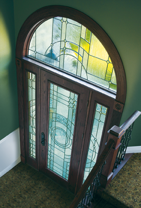 A rounded transom positioned above an entry door.