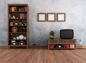 A vintage living room with a bookshelf made from an old door.