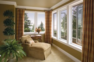 A living space with wide-open casement windows letting fresh air in.