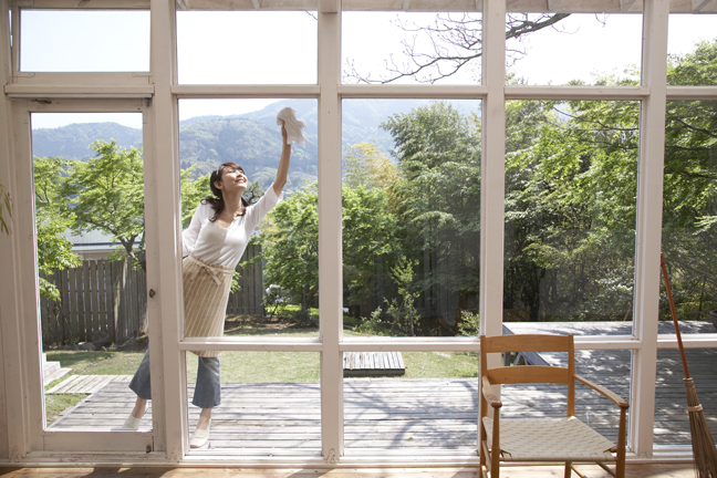 Woman on patio cleaning windows