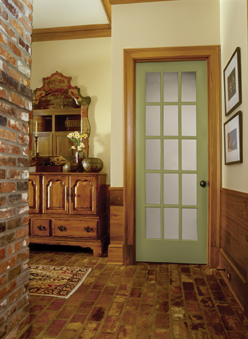 A green french door in a living space