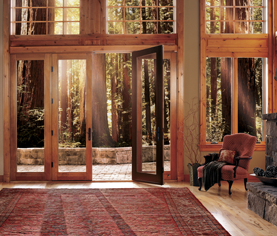 Swinging patio doors and casement windows provide an entire wall of light (Custom Wood Collection).