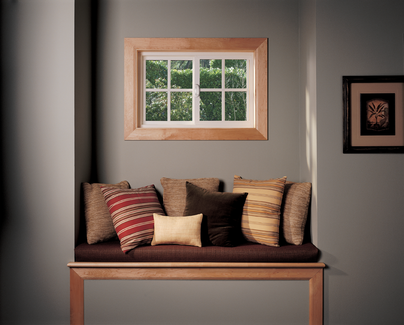 A slider window in a basement nook with a cushioned bench.