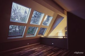 large windows in vaulted ceiling