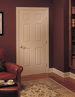 A white interior door in a room with burgundy walls