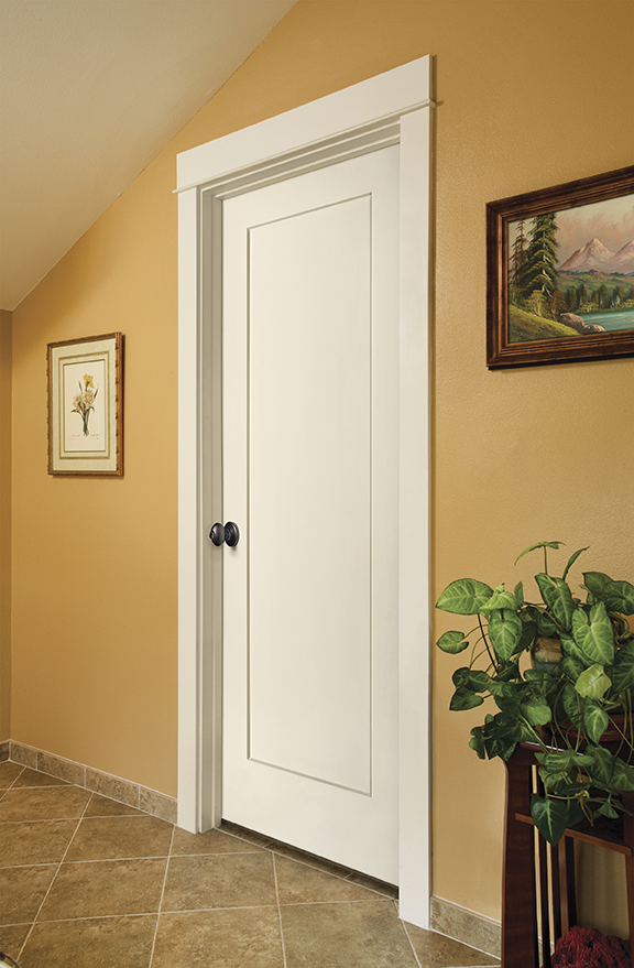Image of a closed, white interior door in a room with yellow wallpaper.