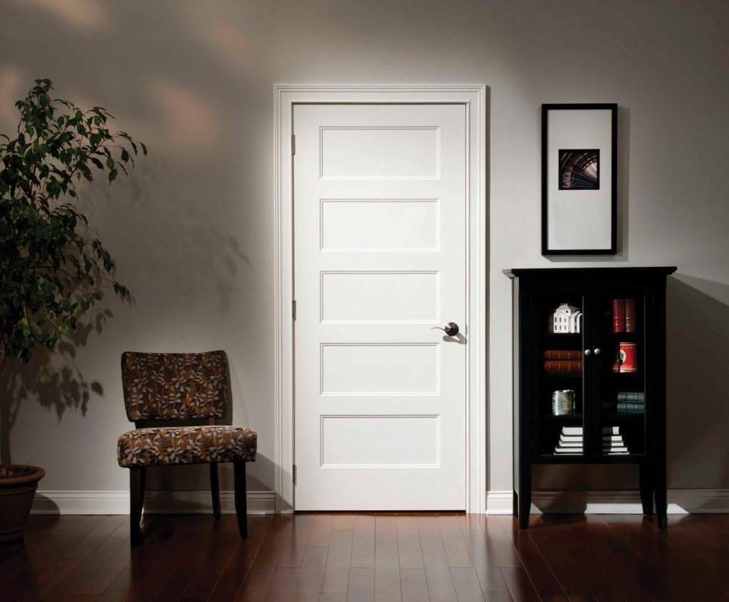 Bright white interior door ina room with hardwood floors.